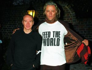 Founding members Midge Ure (left) and Sir Bob Geldof leave Air Studios in north London after the re-recording of 'Do They Know It's Christmas?'. 05/12/04: The new Band Aid single stormed straight into the charts at number one Sunday December 5 2004, after thousands of fans rushed to record stores to buy the charity track. The record is now set to be this year's Christmas number one. Band Aid 20 features Chris Martin, Dido, Robbie Williams and Justin Hawkins of The Darkness and Bono.