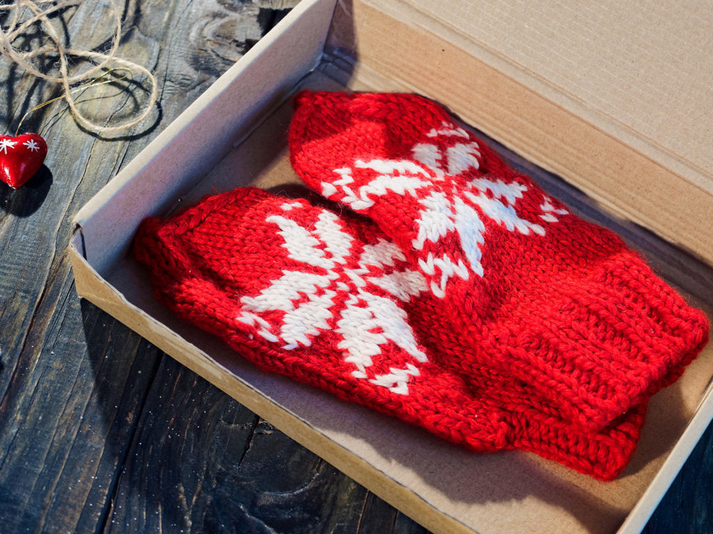 Red mittens in the giftbox Pic: Istockphoto