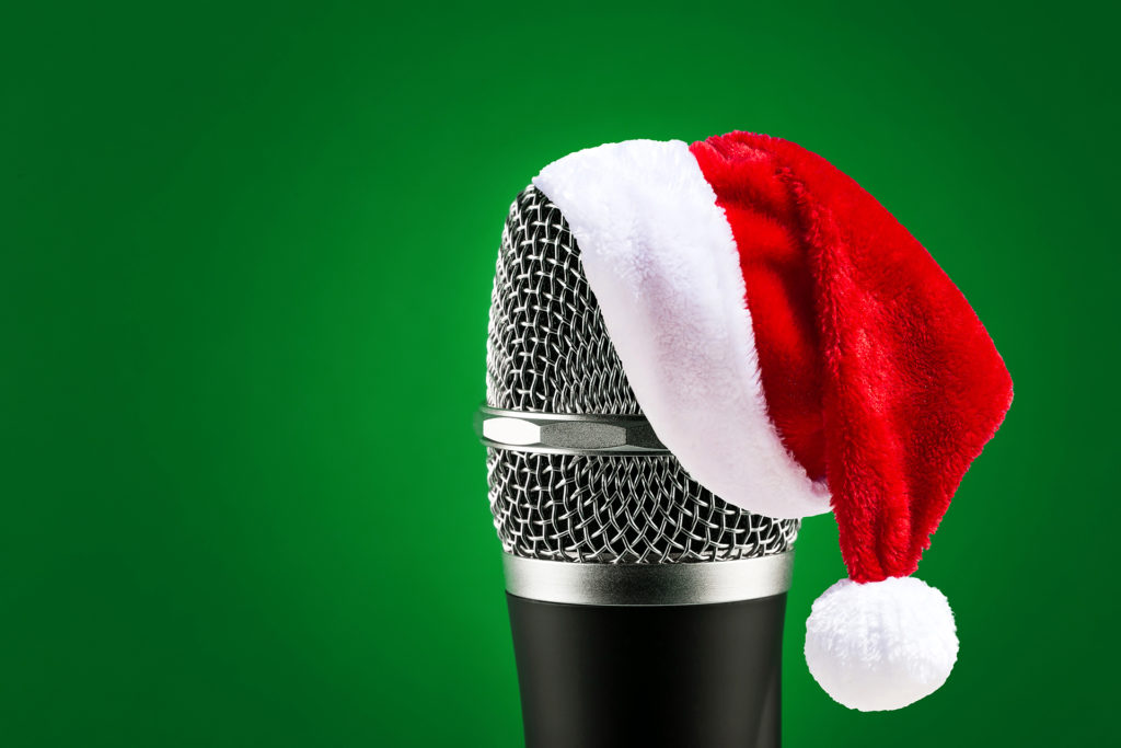 Wireless microphone with Santa hat on it
