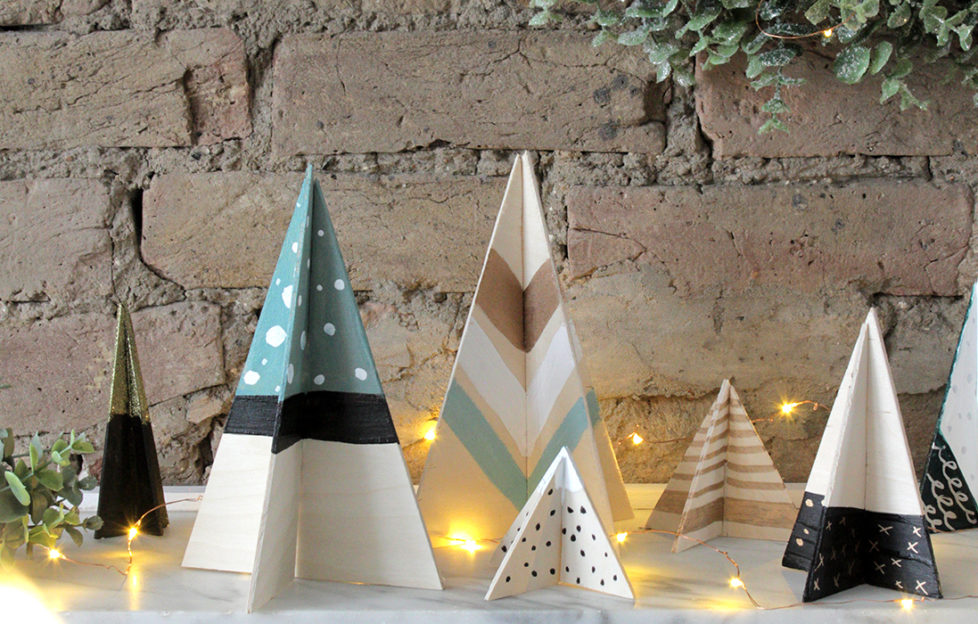 Plywood Scandi Christmas tree decorations, intersecting triangles painted in black, green and white stripes, spots and chevrons using Rust-Oleum paint