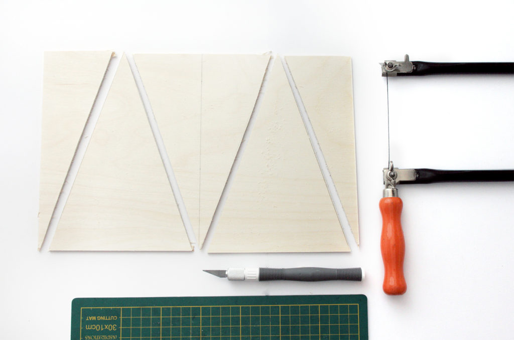 2 isosceles triangles cut from plywood