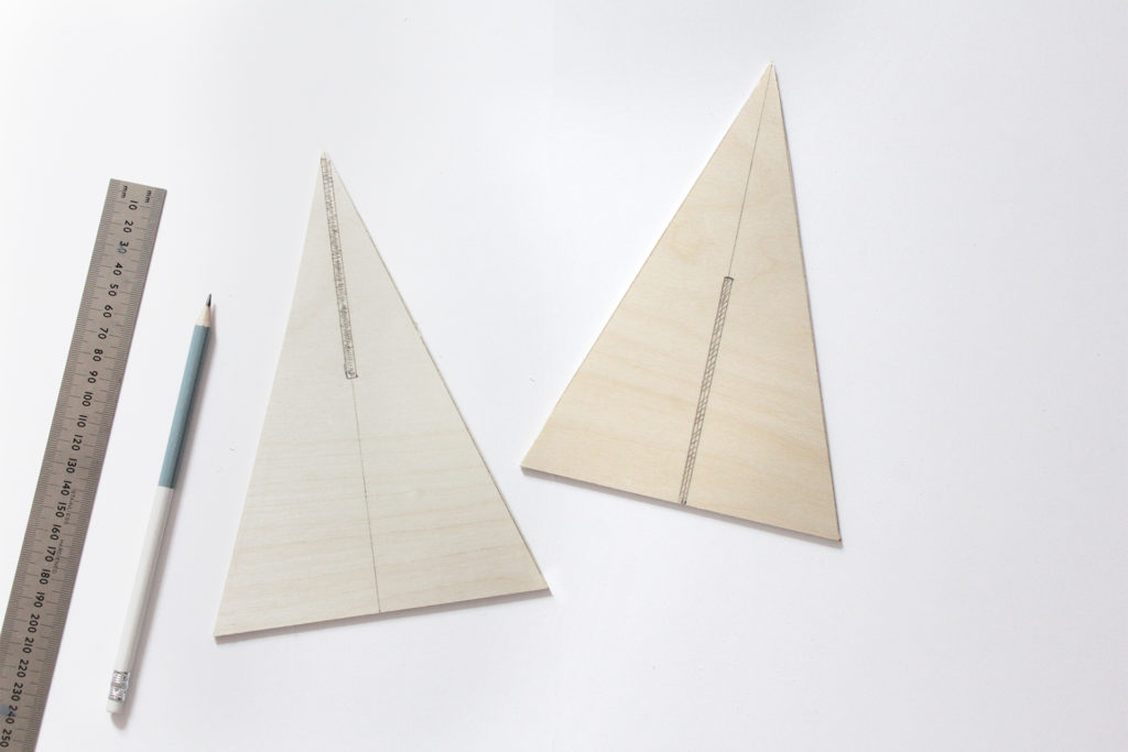 Slots marked on triangles, line up the middle, cut halfway up on one piece and halfway down on the other