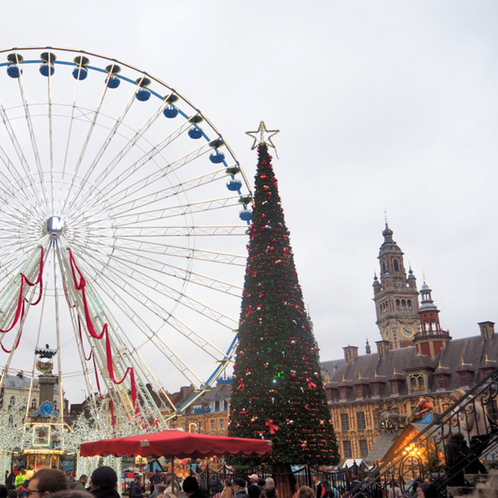 Ferris wheel and Christmas tree, stalls in foreground