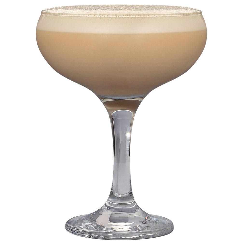 Creamy espresso martini cocktail in a wide champagne glass