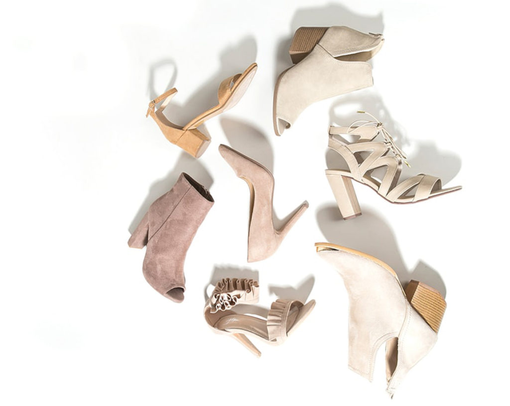 Assortment of cream and beige hoes and ankle boots lying on their sides